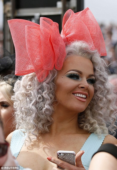 A woman stood out from the crowd in a large bow shaped fascinator