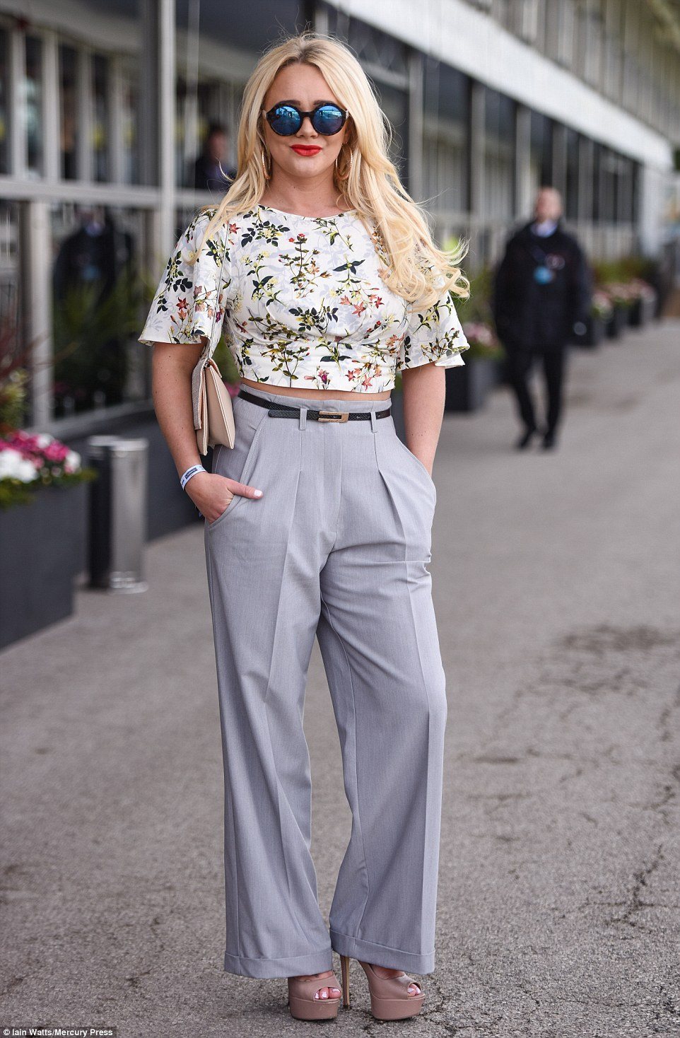 Kirsty-Leigh Porter rocked a pair of wide legged trousers and a summery floral top that showed off a hint of her midriff