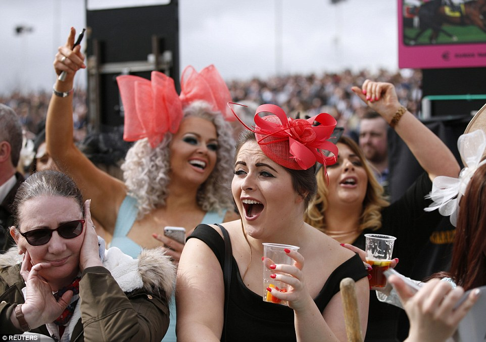 Racegoers react near the end of the 2.15 The Imagine Cruising First in the Frame Top Novices' Hurdle Race Action