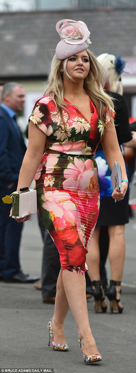 A woman went for head to toe florals and carried a nude box clutch