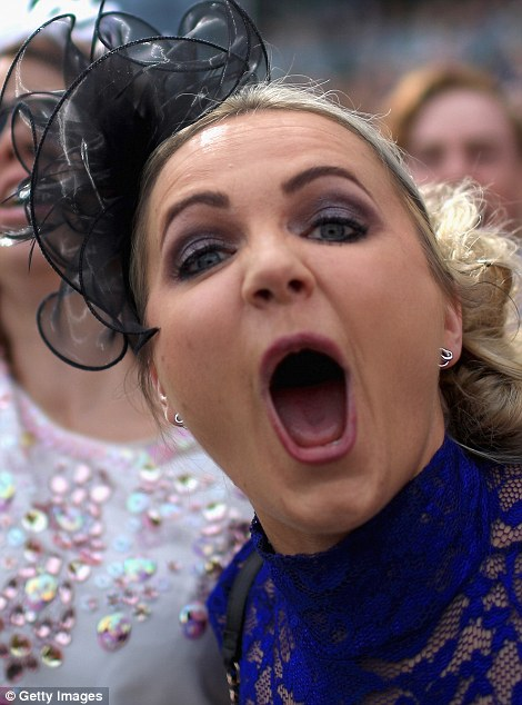 A woman celebrates a win at Aintree