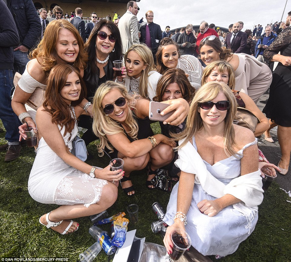 Selfie time: A bunch of pals crouched down for a group photo but the girl in front missed out on being in the photo