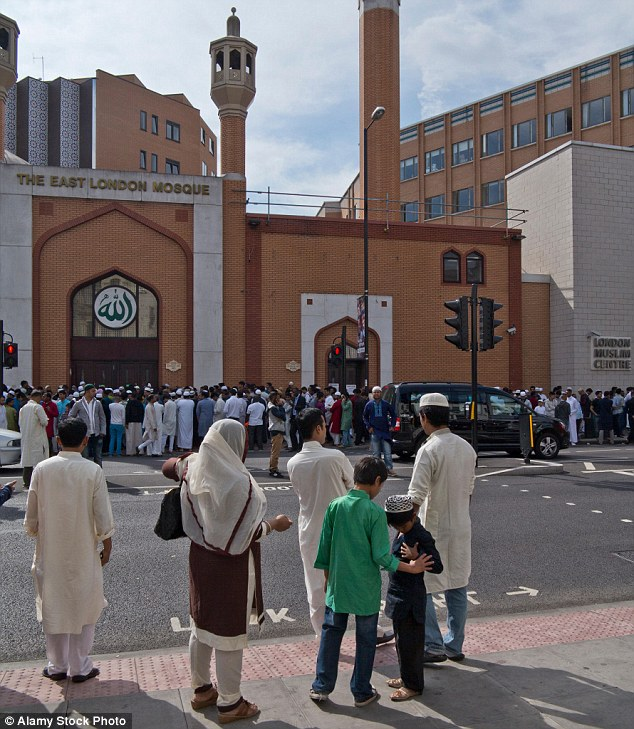 , LoMuslims celebrate Eid Mubarak, at the end of Ramadan, by the East London Mosque in Whitechapel