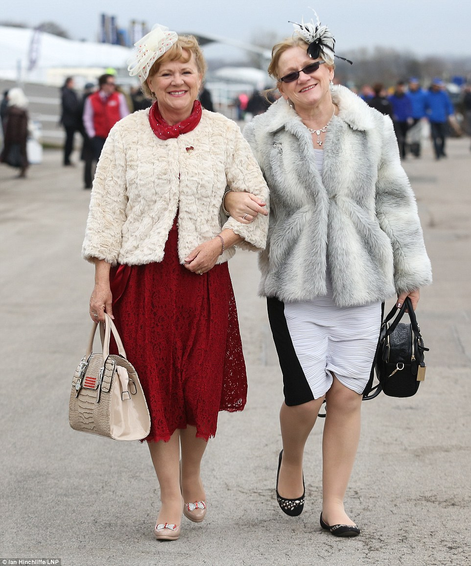 My fur ladies: Two friends opted for cosy cover ups to see them through the day