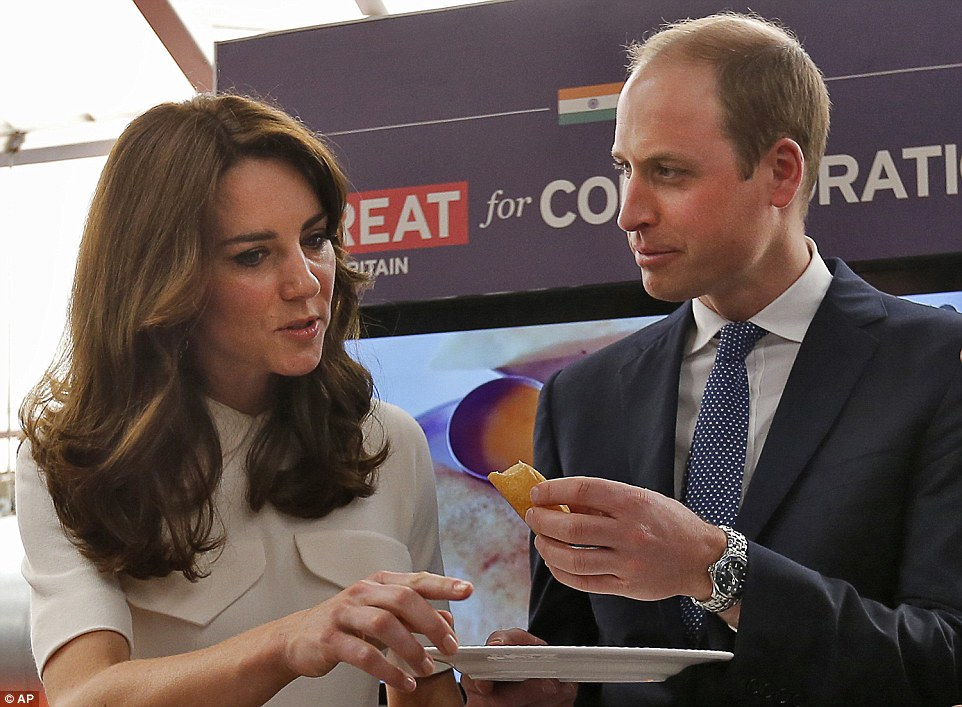 Not so keen: After trying his creation, William offers Kate a bite, however the famously slim royal waved the food away with her hand