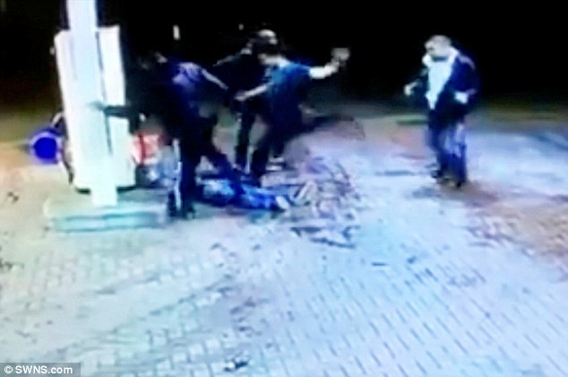 Brutal: Shocking CCTV footage has captured the horrific assault of a 25-year-old man whose head was repeatedly booted against a petrol pump by a gang of thugs at a garage forecourt in Birmingham