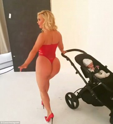 Bodacious: She certainly seemed to be enjoying flaunting her assets despite the very young child being around