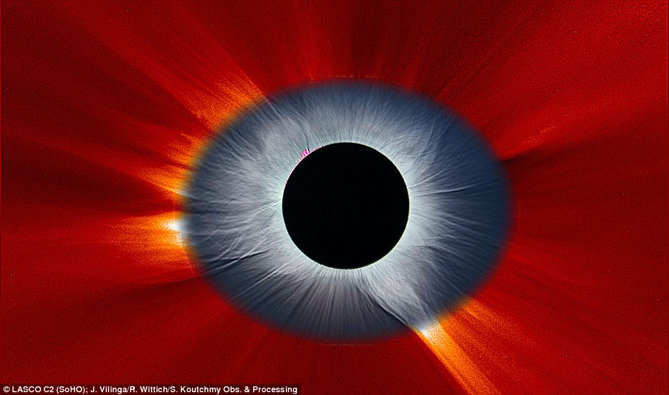 The composite image shows the solar corona, which is an aura of plasma that surrounds the sun and extends millions of miles into space. The blue part of the image shows the total eclipse from the ground, with the central pupil created by the bright sun covered by a comparatively dark moon. The red section was viewed from space, acquired by the sun-orbiting Solar and Heliospheric Observatory