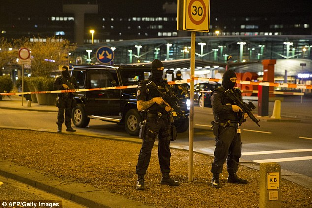 Bomb squad: One man has been arrested and his luggage is being searched by a bomb squad