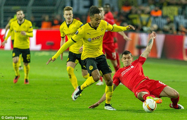Dejan Lovren gets a tackle in on Dortmund's Pierre-Emerick Aubameyang in the first leg clash in Germany