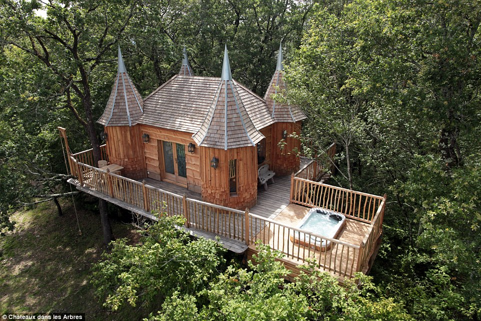 Perched among the branches in a rural spot near Bergerac is a unique treehouse, complete with four fairytale turrets and all built out of wood