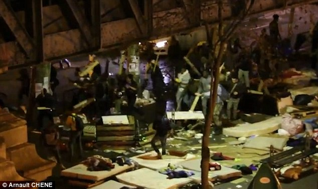 War on the streets:Under the Stalingrad metro in Paris residents filmed the shocking scenes from up high