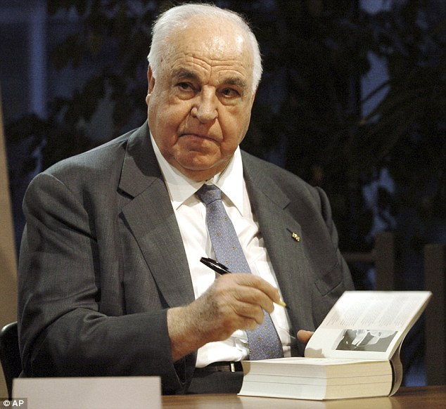 Helmut Kohl signs copies of his book 'Memories 1982-1990' in November 2005. In comments attacking Merkel's open-door policy, Kohl said Europe's peace and freedom could be at stake through mass migration