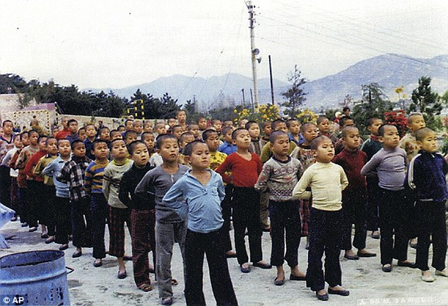 Nobody has been held accountable to date for the rapes and killings at the Brothers compound (pictured) in Busan, South Korea, an investigation has claimed. Children are pictured at the camp