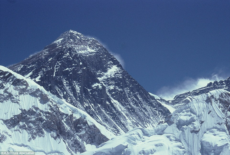 The summit of Everest is pictured against a backdrop of blue sky - but the weather conditions are often incredibly treacherous