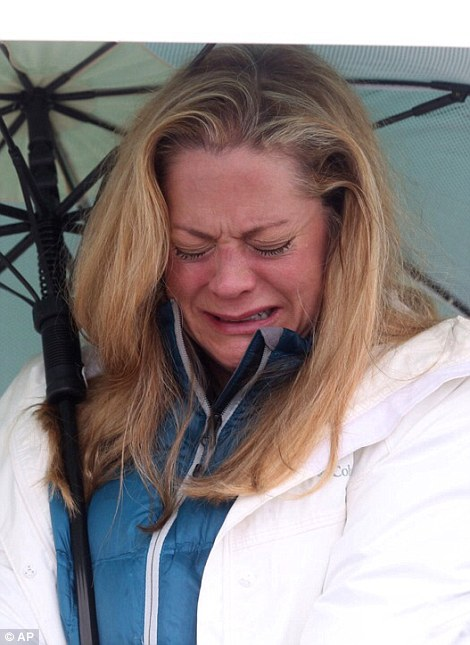 Sue Brown, from Eden Prairie, Minnesota, reacts to the news of the death of Prince