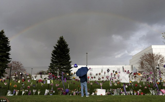 A rainbow appears over Paisley Park near a memorial for Prince, where fans brought flowers and cards for the late pop icon