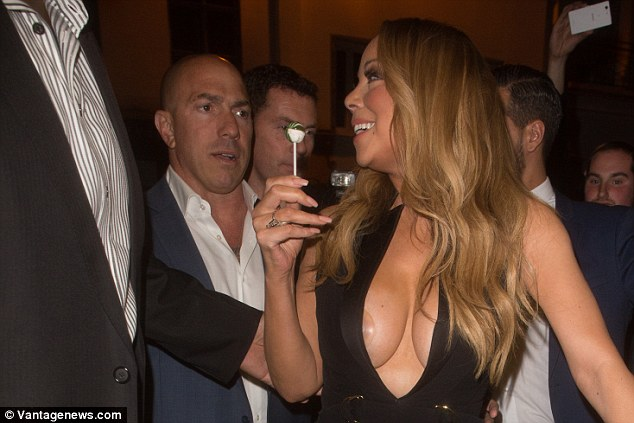 In the mood to party: Mariah was clearly riding high after performing in the French capital. She didn't stop smiling from the moment she arrived through until 5.30am when she finally decided to call it a night