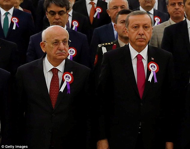 In charge: As parliamentary speaker, Kahraman, pictured with Turkish President Recep Tayyip Erdogan, is responsible for overseeing efforts to draft a new constitution