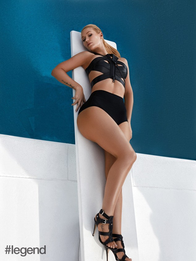 Making a splash: The Fancy hitmaker posed seductively while laying on a diving board and wearing a black bikini with matching strappy leather heels