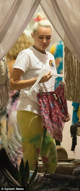Boho babe: The We Can't Stop star chose a pretty pair of shorts for trying on