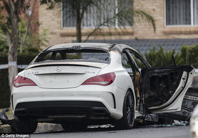 Police said a torched Mercedes used in the shooting was found in a street just one kilometre from the shopping centre