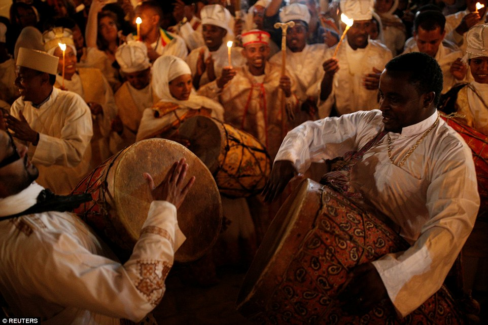 Ethiopian Orthodox worshippers dance during the Holy Fire ceremony at the Ethiopian section of the Church of the Holy Sepulchre in Jerusalem's Old City