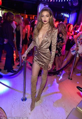 All about me! Before entering the club's VIP area, Gigi made sure to showcase her stunning outfit once again