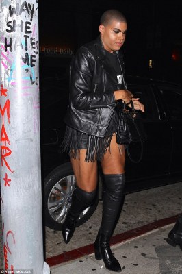 His look: EJ wore a designer T-shirt underneath a leather jacket. The reality star added a pair of mini shorts, layered under a fringe, skirt-like belt