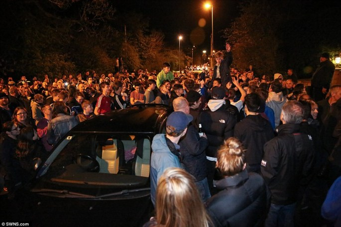 Crowds celebrate outside the Melton Mowbray home of Jamie Vardy after Leicester City win the Premier League