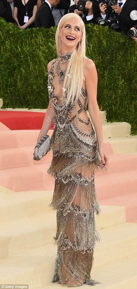 Hot metal: Poppy Delevingne arrived in a shimmering semi-sheer gown as she laughed on the arrivals carpet