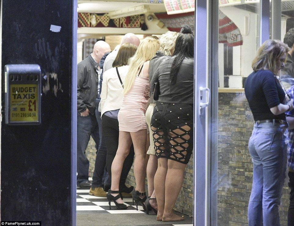 A group of young women queue up at a takeaway following a night out in Newcastle to make the most of the three-day May Bank Holiday