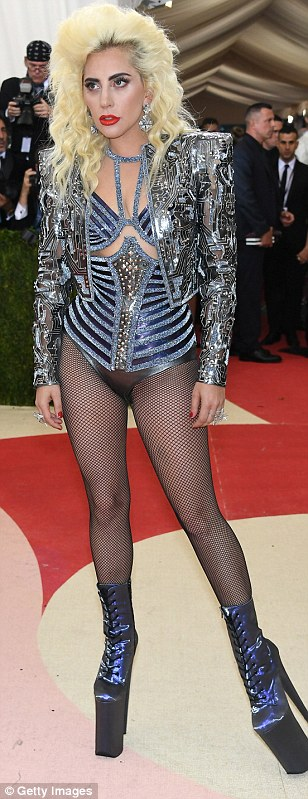 Cyber gaga: Lady Gaga really embraced the theme this year with the 1980s version of futuristic in a glittering, striped body suit under a wide-shouldered jacket decked with computer chip patterns and a towering pair of shiny, lace-up boots