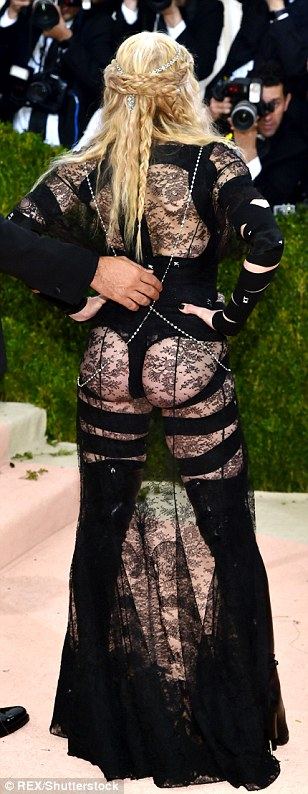 Putting it out there: The 57-year-old pop icon showed off much of her figure in the revealing lace number with thigh-high boots