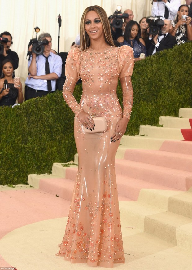 Bucking the trend: While many went for metallic looks, Beyonce rocked a peachy latex gown with floral detailing