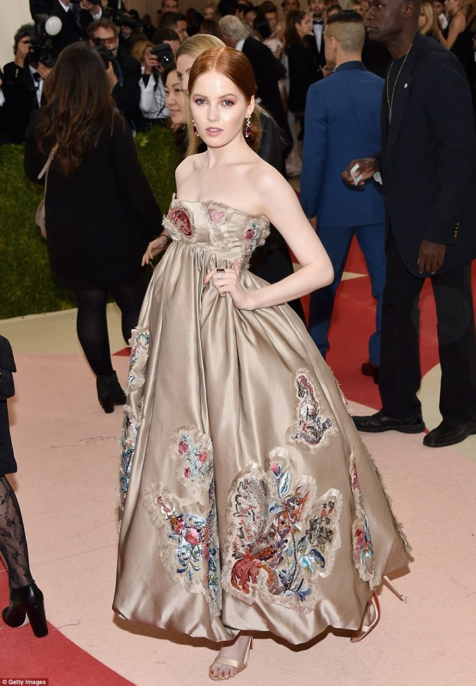 Hidden away: Frayed embroidery, a very painful-looking foot and a complete lack of a waistline make Ellie Bamber's dress a flop