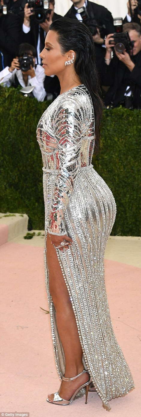 Silver stunner: Kim Kardashian appeared to be literally encased in body armour with her futuristic look