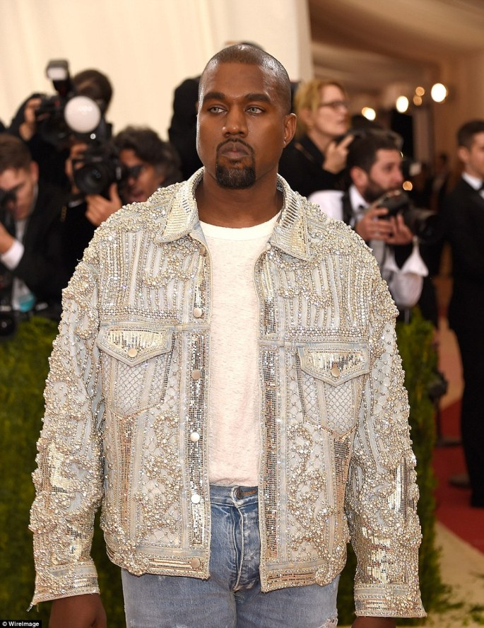 Bedazzled: Kanye took the casual look to the sparkling extreme in this jacket and also donned a pair of greenish contact lenses