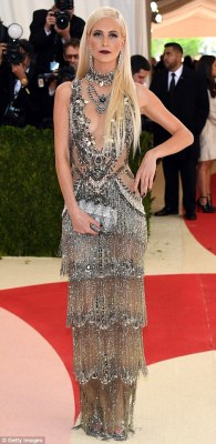 Hot metal:Poppy Delevingne arrived in a shimmering semi-sheer gown and Sofia Richie opted for gold