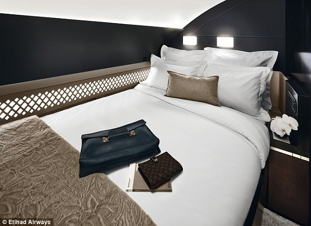 Down the hall, passengers can retreat to a bedroom with a double bed - another first for a commercial jet