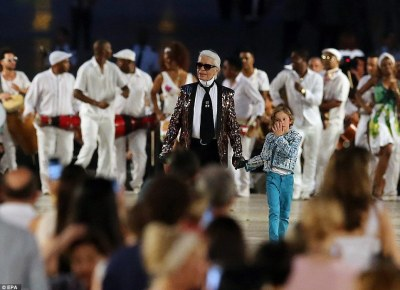 German designer Karl Lagerfeld (center) closes the runway in Havana, after holding the fashion house's first catwalk in Latin America