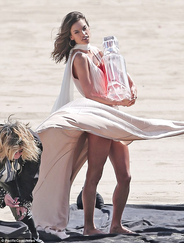 Heaven scent! It's possible Alessandra's line may be on its way to launching a fragrance component, given that the model was photographed clutching a giant sized perfume bottle