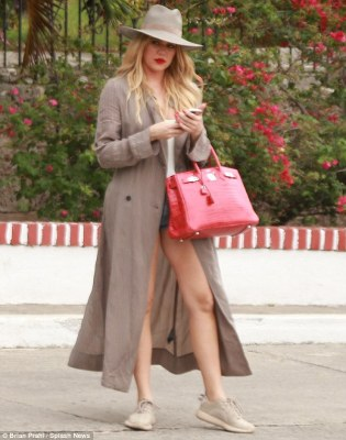 On a trip: Khloe has been in Cuba this week with her sisters Kim and Kourtney
