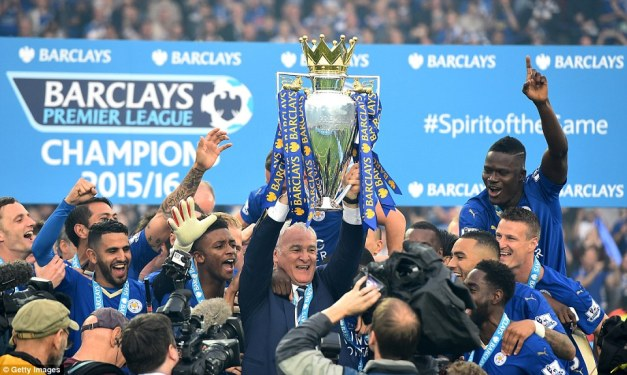 Leicester City manager Claudio Ranieri (centre) lifts the trophy have led his side to an historic Premier League crown this season