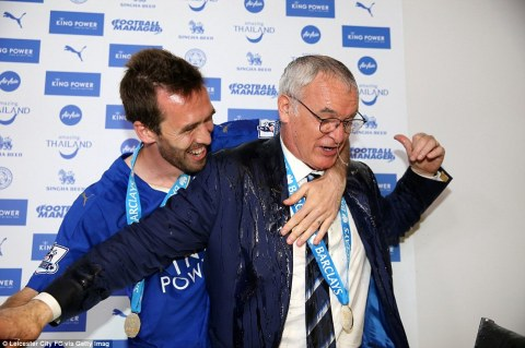 Fuchs gives Ranieri a hug after soaking him with champagne. The former Chelsea boss is a hugely popular figure with the Foxes