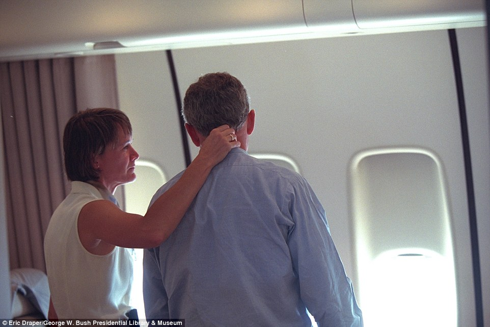 A third plane flew into the Pentagon in Arlington County, Virginia, at 9:37 a.m. and Bush's administration struggled to gather information in the midst of the attacks as estimated numbers of casualties floated around. Pictured, Lieutenant Colonel Cindy Wright consoling Bush
