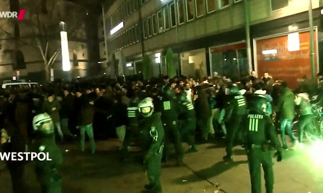 Out of control: Footage of New Year's Eve in Cologne shows the celebrations going terribly wrong as police try to control the huge crowds of revellers where hundreds of women were sexually abused