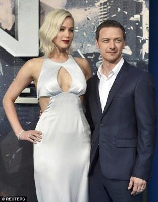 Towering over him: Jennifer made James look diminuitive