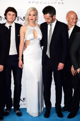 Turning heads:Jennifer also seemed to distract director Simon Kinberg (right)