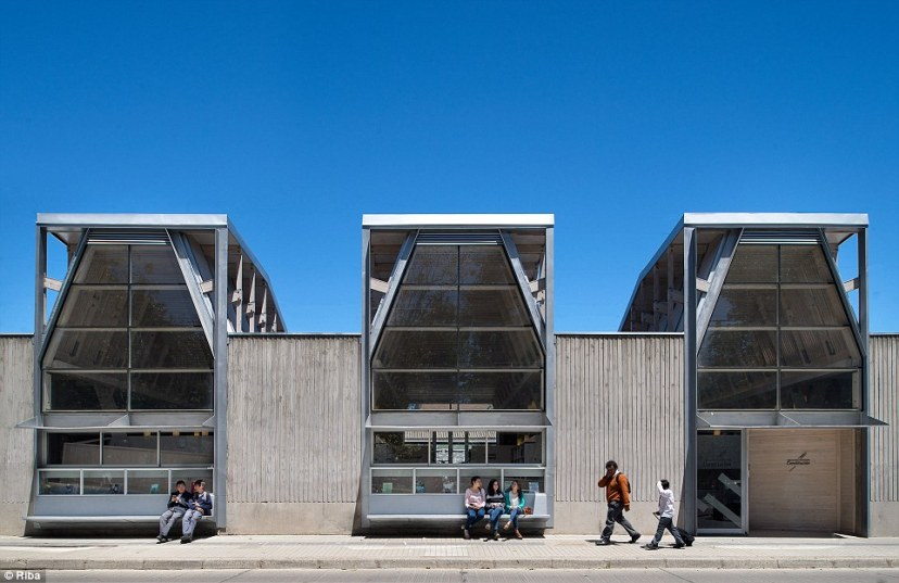 The Public Library of Constitucion in Chile opened last year. The scheme is part of efforts to rebuild the city of Constitución after an earthquake and tsunami that devastated the town in 2010. Local carpenters helped to build the highly crafted building